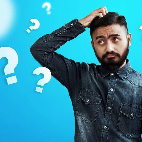 Man scratching head looking confused