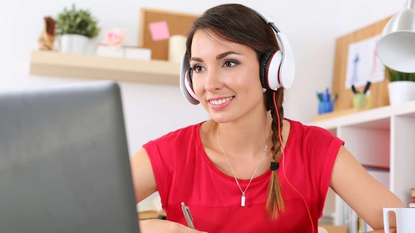 Woman at laptop taking an online seminar